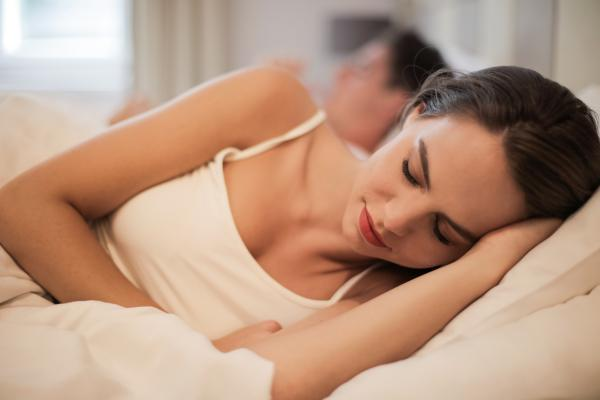 Canva Charming woman sleeping in bed at home